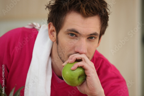 Man about to eat an apple