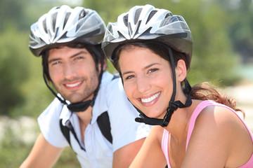 Couple with bicycle helmet