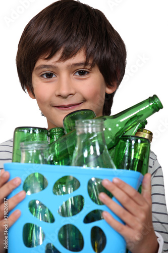 Little boy with glass bottles