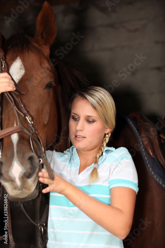 juvenile blonde with horse