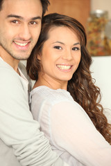 Smiling couple indoors