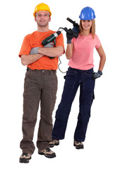 Man and woman with power drills
