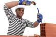 Man chipping away at brick