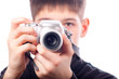 Teenager taking pictures with camera