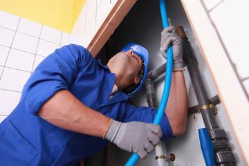 Plumber pulling tube