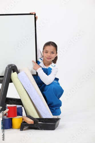 Little girl dressed as decorator