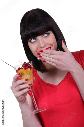 Woman eating a fruit salad