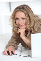Smiling relaxed woman with laptop computer