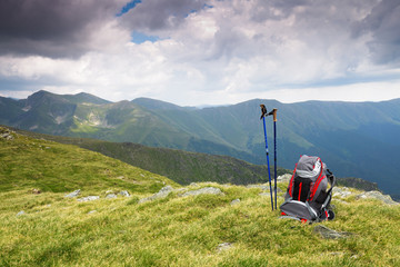 hiking pole and backpack in mountain