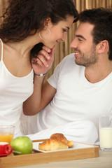 Couple enjoying room service