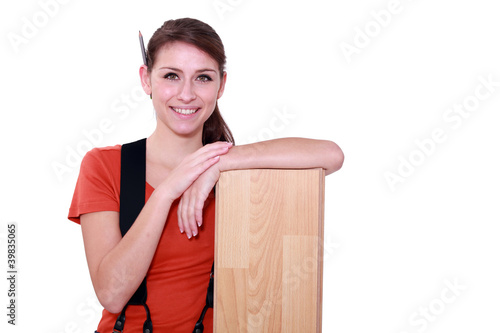 Female carpenter with laminate flooring