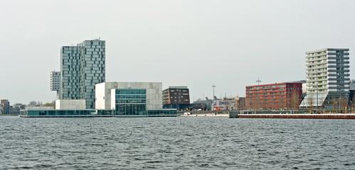 Skyline of a city along a lake