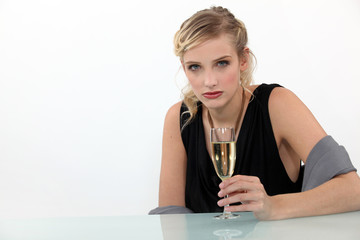 Crying woman drinking a glass of champagne