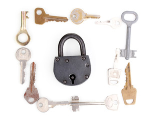 Metal keys and padlock isolated on white