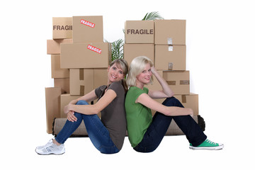 Two women moving house