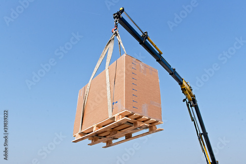 Crane elevating a box