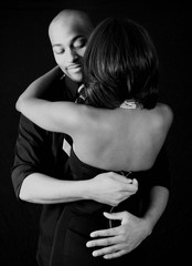 black couple, him unzipping her dress