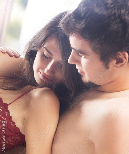 Young amorous couple at bedroom