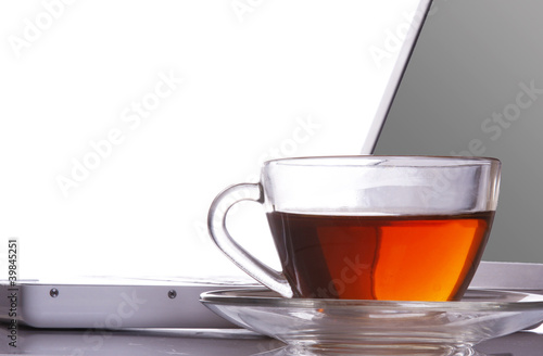 Tea flowing in cup