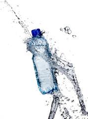 Fresh water splashing out of bottle on white background
