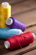 coloured bobbins of thread