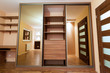 Modern apartment interior with huge wardrobe