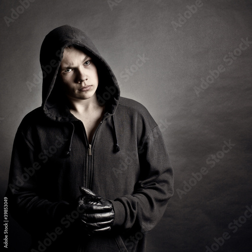 Portrait of the young man in a hood