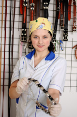 Woman veterinarian chooses collar and leash for your dog