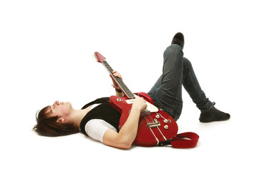 A rock guitarist lying on the floor