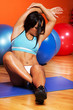 Beautiful sport woman doing stretching fitness exercise at sport