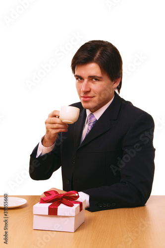 businessman with gift on white