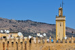 Part of old city wall and minaret in Fes, Morocco