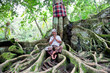 Spiritual man sits under the tree, Bali