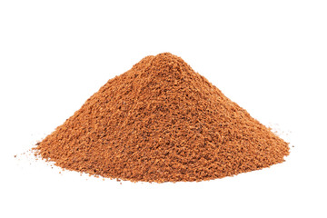 Heap of ground Cinnamon isolated on white background.