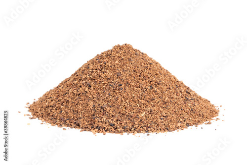 Pile of Nutmeg powder (Myristica fragrans) isolated on white