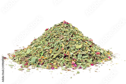 Pile of ground dried Basil (Sweet Basil) isolated on white
