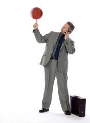 Business Man and Spinning Basketball