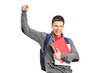 A happy student holding books and gesturing