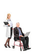 Nurse pushing a busy businessman working on a laptop in a wheelc