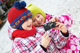 Two funny little girls with camera
