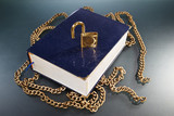 Book with golden chain and lock
