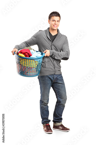 Full length portrait of a man holding a laundry basket