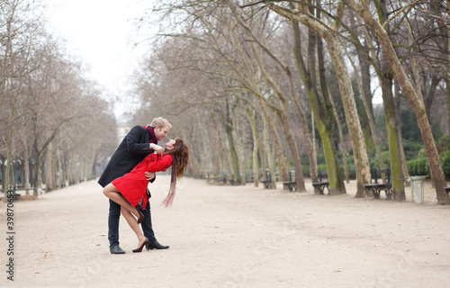 Dating couple dancing in a park