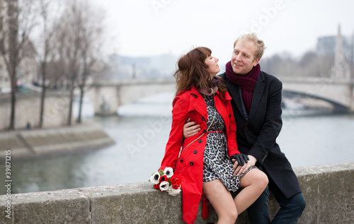 Dating couple at the Parisian embankment