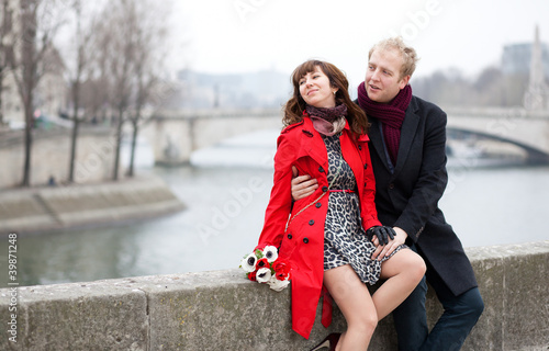 Dating couple at the Parisian embankment at misty day