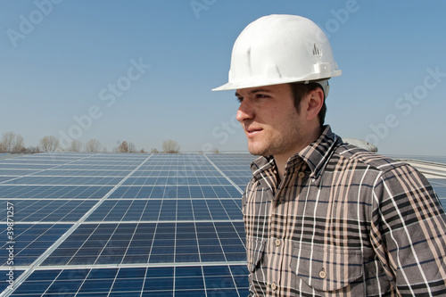 Worker in front of a photovoltaic plant
