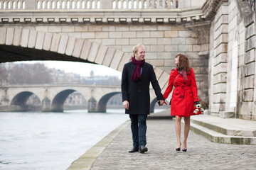 Beautiful romantic couple on a Parisian embankment at spring or