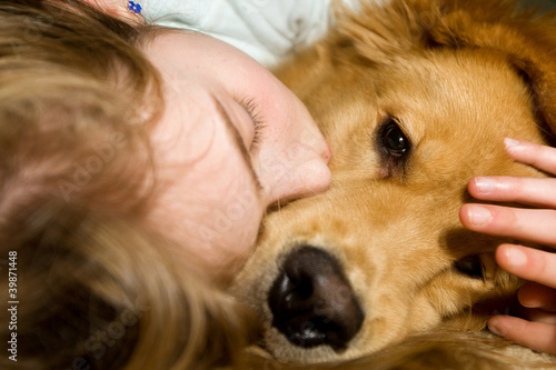 Young girl sleeping with her best friend the dog.