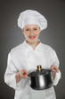 Young female chef  with pot