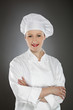 Confident young female chef